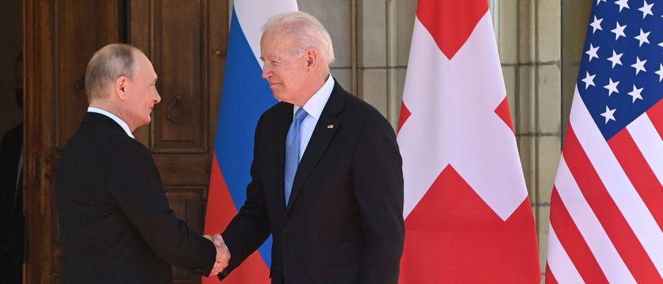 US President Joe Biden and Russian President Vladimir Putin shake hands as they arrive at Villa La Grange in Geneva, Switzerland, for the start of their summit on June 16, 2021. (SAUL LOEB/POOL/AFP via Getty Images)