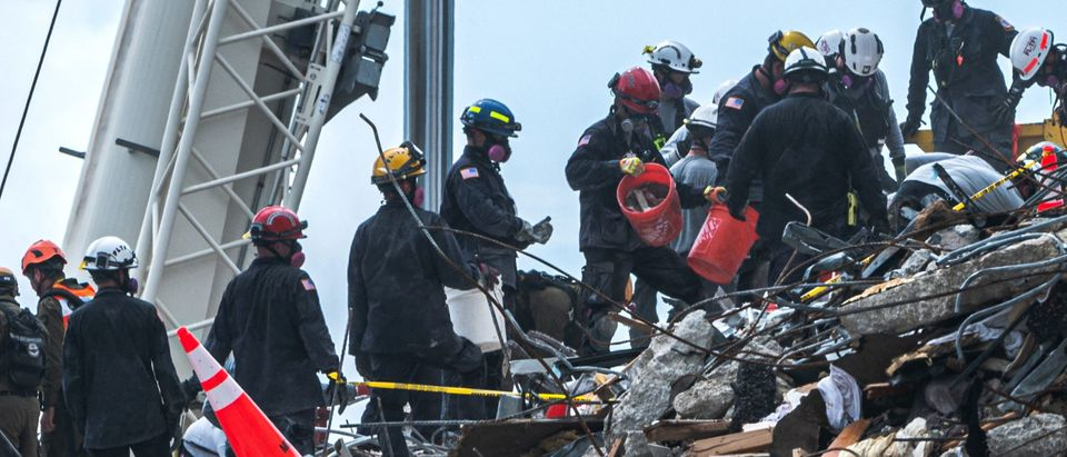 """Search and Rescue teams look for possible survivors and to recover remains in the partially collapsed 12-story Champlain Towers South condo building on June 29, 2021 in Surfside, Florida. - The death toll after the collapse of a Florida apartment tower has risen to nine, the local mayor said on June 27, 2021, more than three days after the building pancaked as residents slept. """"We were able to recover four additional bodies in the rubble... So I am confirming today that the death toll is at nine,"""" Miami-Dade County mayor Daniella Levine Cava told reporters in Surfside, near Miami Beach, adding that one victim had died in hospital. """"We've identified four of the victims and notified next of kin."""" (Photo by Giorgio Viera/AFP via Getty Images)"""
