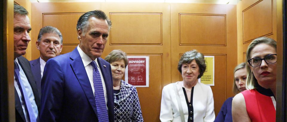 (L-R) U.S. Sens. Mark Warner (D-VA), Joe Manchin (D-WV), Mitt Romney (R-UT), Jeanne Shaheen (D-NH), Susan Collins (R-ME) and Kyrsten Sinema (D-AZ) take a break from a meeting on infrastructure for going to a vote at the U.S. Capitol June 8, 2021 in Washington, DC. (Alex Wong/Getty Images)