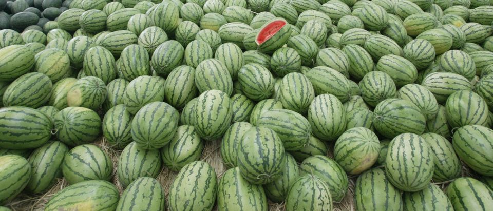 Vendors Sell Water Melons At A Market