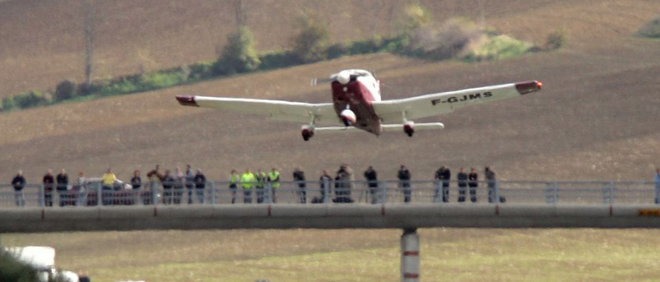 A Piper PA28 takes off from a freeway, 1