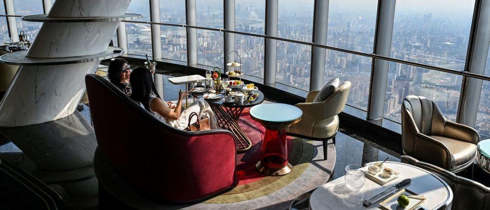 Guests enjoy J Hotel in Shanghai Tower, the world's hightest luxury hotel in Shanghai. Photo by Hector Retamal. Getty.