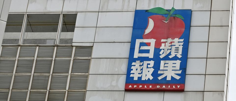 The logo of Next Media and Apple Daily are seen on their headquarters in Hong Kong on June 22, 2021. (Photo by PETER PARKS/AFP via Getty Images)