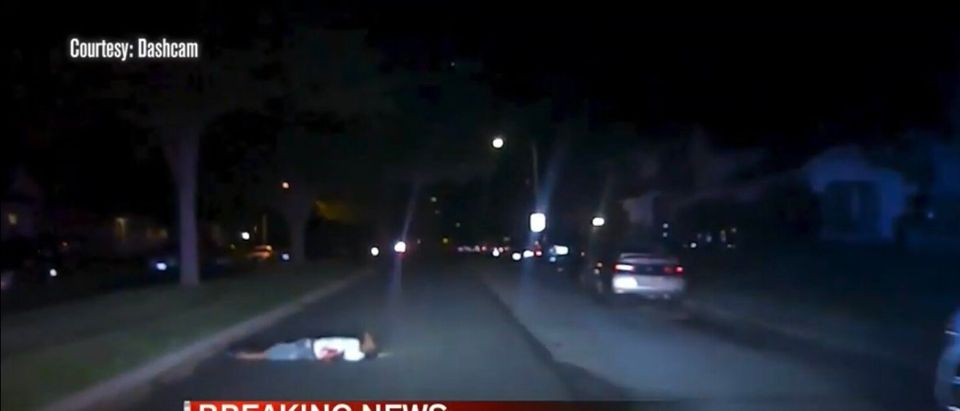 Police camera footage shows Eric Cole laying on the street after being shot in the arm.