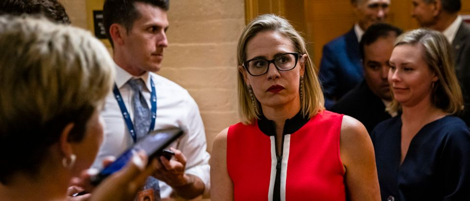 Sen. Kirsten Sinema of Arizona heads back to a bipartisan meeting on infrastructure in the Capitol building on June 8, 2021 in Washington, DC. (Photo by Samuel Corum/Getty Images)
