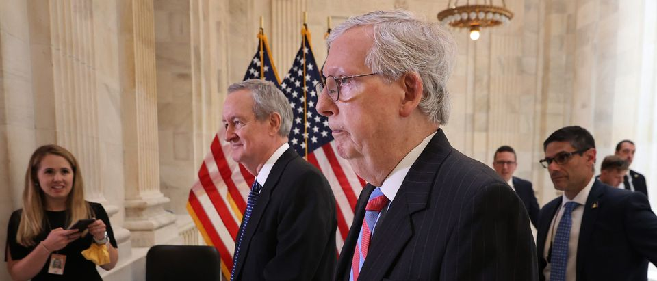 Republican Senators Mitch McConnell and Mike Crapo walk together in the Capitol Building. (Photo by Chip Somodevilla/Getty Images)