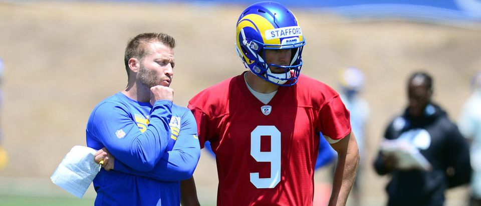 May 27, 2021; Thousand Oaks, CA, USA; Los Angeles Rams head coach Sean McVay speaks with quarterback Matthew Stafford (9) during oraganized team activities. Mandatory Credit: Gary A. Vasquez-USA TODAY Sports via Reuters
