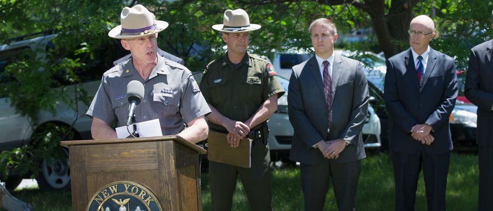 New York State Police officer Maj. Charles Guess holds a press conference. (Photo by Scott Olson/Getty Images)