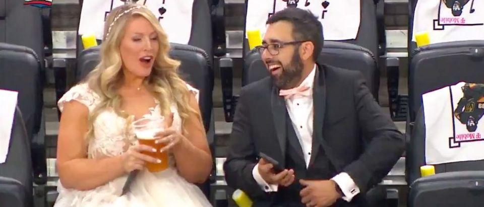 Newlyweds (Credit: Screenshot/Twitter Video https://twitter.com/Sportsnet/status/1404597920670814213)