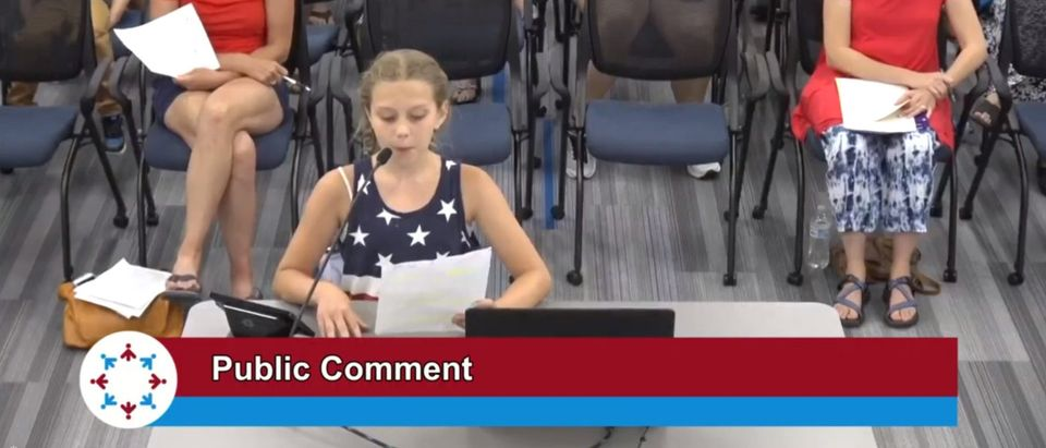 Photo of girl at school board