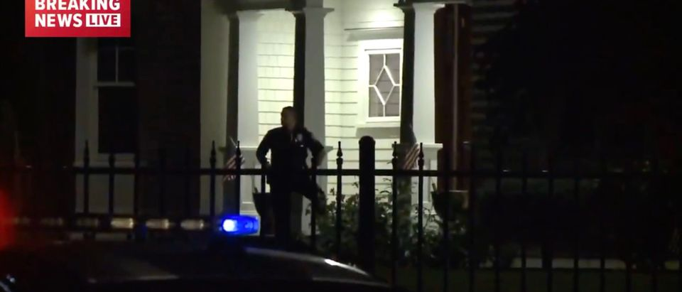 Police Officer stands outside the Westport, CT home where a woman and child were found deceased [Twitter:Screenshot:Zinnia Maldonado]