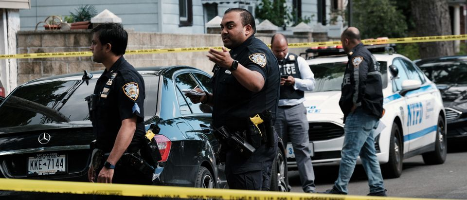 Police investigate the scene of a shooting in Brooklyn on June 23, 2021 in New York City. (Photo by Spencer Platt/Getty Images)