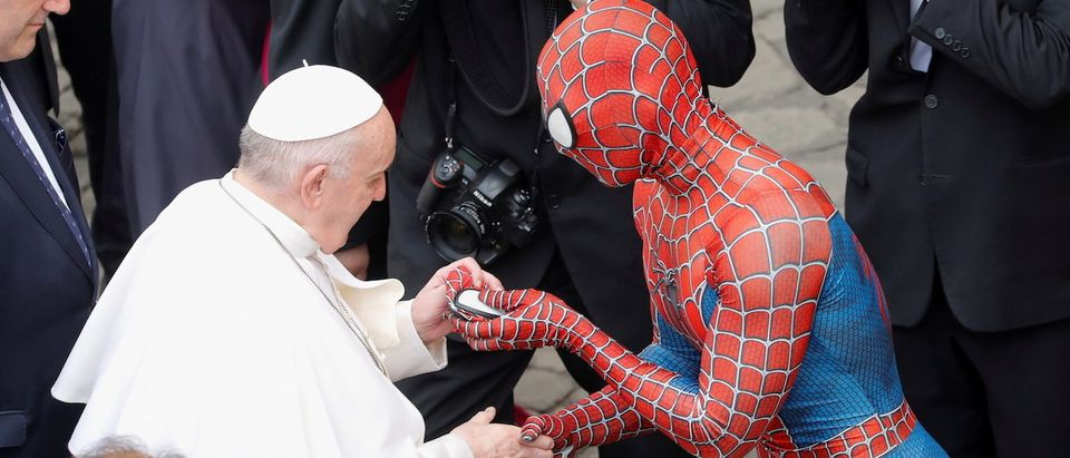 Pope Francis greets a person dressed as Spider-Man, at the Vatican