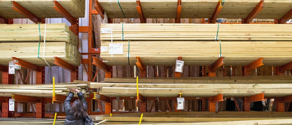 Lumber stacked up in a Home Depot store. (Photo by Scott Olson/Getty Images)