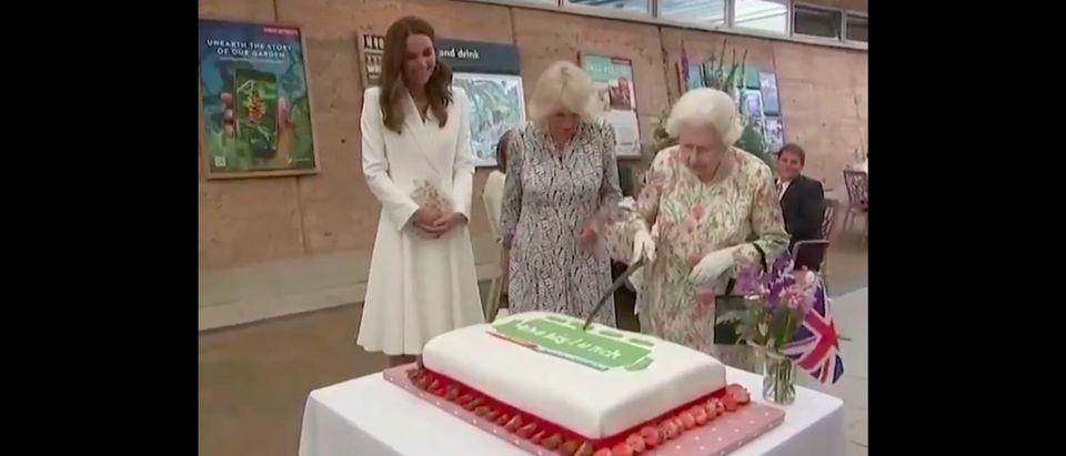 Queen Elizabeth II cut a cake using a ceremonial sword at the G7 summit.