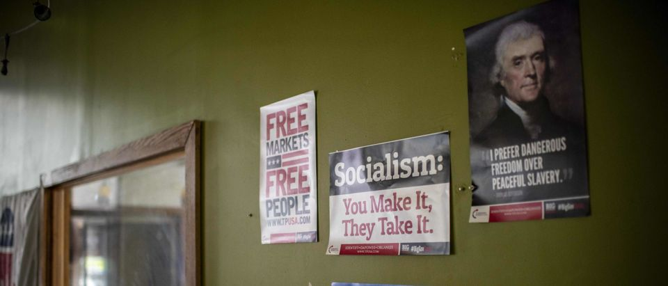 Signs against socialism are seen hanging on the wall as Republican Party Chairman for the Lackawanna County, Lance Stange, gives an interview to AFP on August 12, 2020 at the party local HQ in Scranton, Pennsylvania.(Photo by ERIC BARADAT/AFP via Getty Images)
