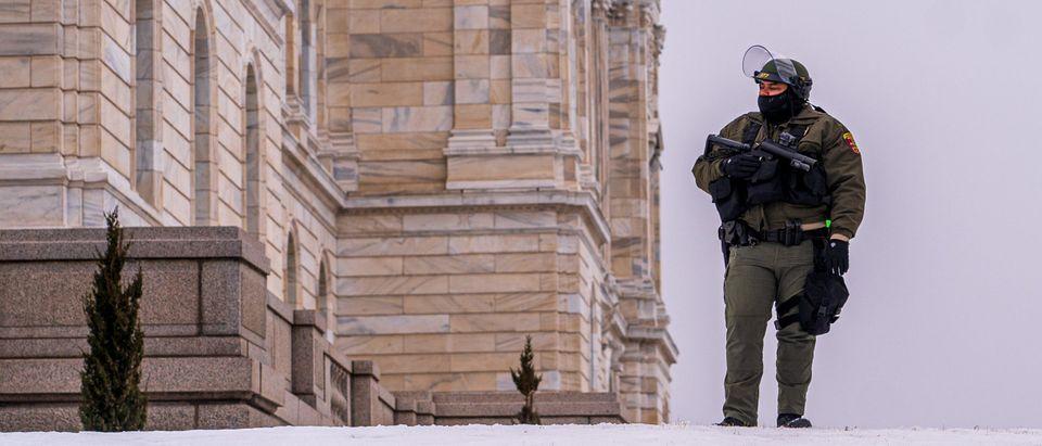 A Minnesota State Trooper stands guard in St. Paul, Minnesota on January 17, 2021(Photo by Kerem Yucel / AFP) (Photo by KEREM YUCEL/AFP via Getty Images)