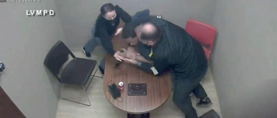 Terrell Rhodes appears to lunge for a detective's gun during an interrogation [Twitter:Screenshot:Fox 5 Vegas]