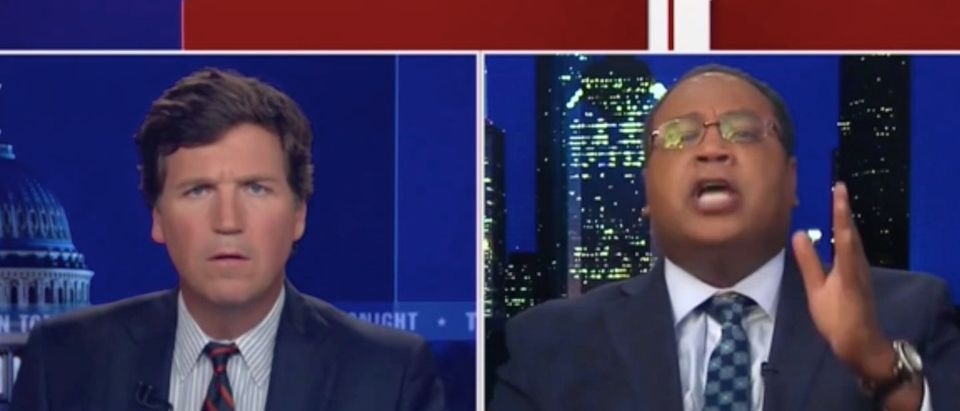 Horace Cooper (R) and Tucker Carlson