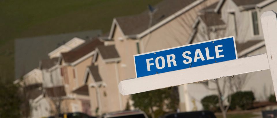 A for sale sign is seen on a single family home. (Photo by David Paul Morris/Getty Images)