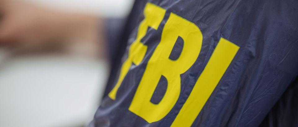 FBI agent wearing jacket [Shutterstock]