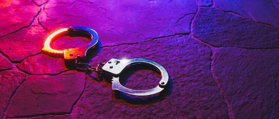 Handcuffs on floor [Shutterstock]