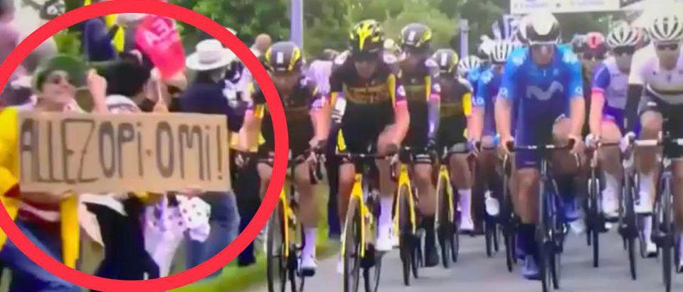 A fan holding a sign caused a huge bike crash at the Tour de France. Screenshot. Twitter. @BubbaProg.