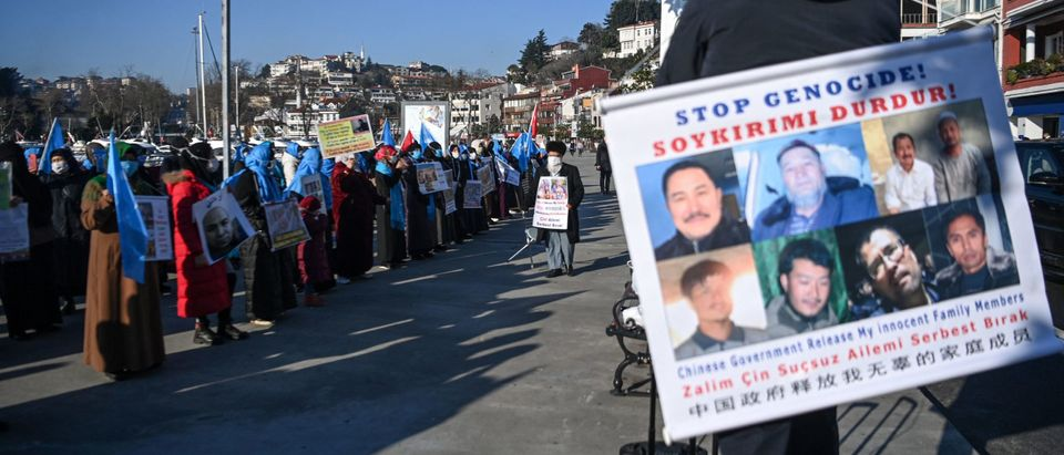 Turkish Uyghurs draw attention to the minority's genocide in China. (Photo by OZAN KOSE/AFP via Getty Images)
