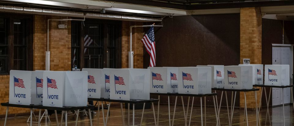 Empty voting booths are seen in Flint, Michigan at the Berston Fieldhouse polling place on November 3, 2020. (Photo by SETH HERALD/AFP via Getty Images)