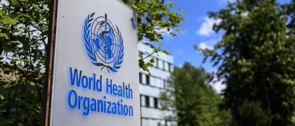 A sign of the World Health Organization (WHO) in Geneva next to their headquarters, amid the COVID-19 outbreak, caused by the novel coronavirus. (Photo by FABRICE COFFRINI/AFP via Getty Images)