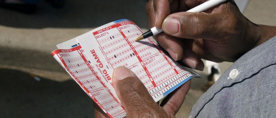 A man selects numbers for a lottery in Milwaukee, Wisconsin. Photo by Tim Boyle. Getty.