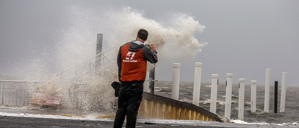 A man watches as Tropical Storm Elsa makes landfall on July 7, 2021 in Cedar Key, Florida. (Photo by Mark Wallheiser/Getty Images)