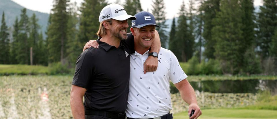 BIG SKY, MONTANA - JULY 06: Aaron Rodgers (L) and Bryson DeChambeau celebrate after winning Capital One's The Match at The Reserve at Moonlight Basin on July 06, 2021 in Big Sky, Montana. (Photo by Stacy Revere/Getty Images for The Match)