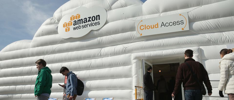 Visitors arrive at the cloud pavillion of Amazon Web Services at the 2016 CeBIT digital technology trade fair. (Photo by Sean Gallup/Getty Images)