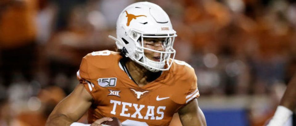 AUSTIN, TX - AUGUST 31: Casey Thompson #8 of the Texas Longhorns rolls out to pass pursued by Ka'Derrion Mason #96 of the Louisiana Tech Bulldogs in the fouth quarter at Darrell K Royal-Texas Memorial Stadium on August 31, 2019 in Austin, Texas. (Photo by Tim Warner/Getty Images)
