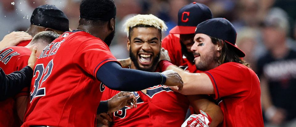 CLEVELAND, OH - JULY 09: Bobby Bradley #44 of the Cleveland Indians celebrates with Franmil Reyes #32 and Austin Hedges #17 after hitting a game winning solo home run off Jake Brentz #59 of the Kansas City Royals during the ninth inning at Progressive Field on July 09, 2021 in Cleveland, Ohio. The Indians defeated the Royals 2-1. (Photo by Ron Schwane/Getty Images)