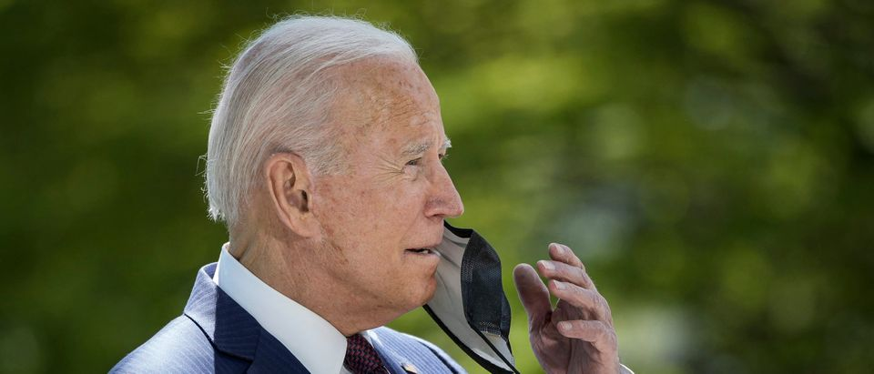 WASHINGTON, DC - APRIL 27: U.S. President Joe Biden removes his mask before speaking about updated CDC mask guidance on the North Lawn of the White House on April 27, 2021 in Washington, DC. President Biden announced updated CDC guidance, saying vaccinated Americans do not need to wear a mask outside when in small groups. (Photo by Drew Angerer/Getty Images)