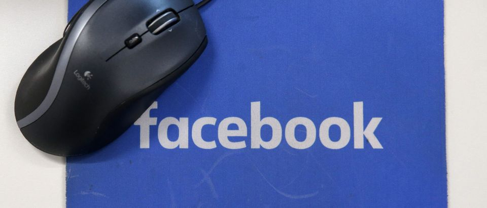 A mousepad with the Facebook logo is seen at Facebook's new headquarters, designed by Canadian-born American architect Frank Gehry, at Rathbone Place in central London on December 4, 2017. Social media titan Facebook opened a new office in London on December 4, 2017, that is set to be its biggest engineering hub outside America, the company has announced. / AFP PHOTO / Daniel LEAL-OLIVAS (Photo credit should read DANIEL LEAL-OLIVAS/AFP via Getty Images)