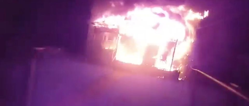 Jamestown Police Officer Mark Conklin rescues three individuals from a burning home early Monday morning [Facebook:Screenshot:Jamestown Police Department]