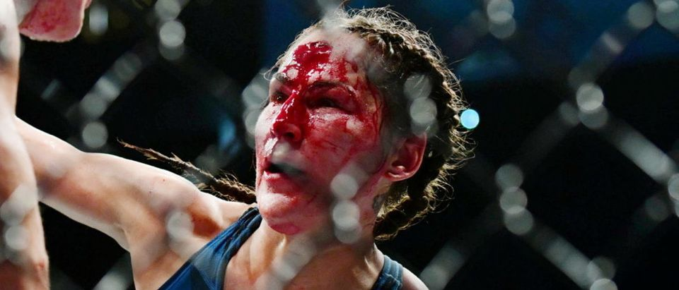 Jul 10, 2021; Las Vegas, Nevada, USA; Jessica Eye moves in for a hit against Jennifer Maia during UFC 264 at T-Mobile Arena. Mandatory Credit: Gary A. Vasquez-USA TODAY Sports via Reuters
