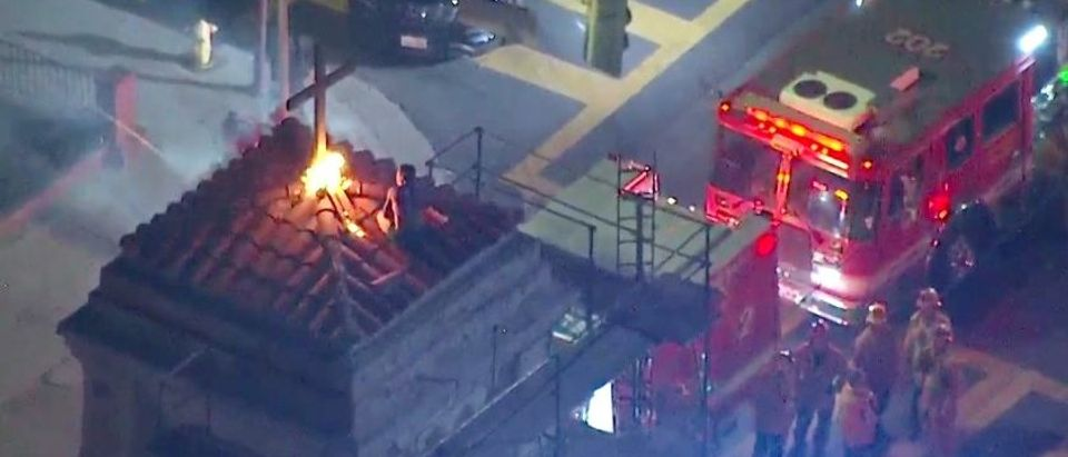 The man who climbed onto the roof of St. Mary's Church in Los Angeles and lit a fire beneath a cross Wednesday night. (Photo by KTLA)