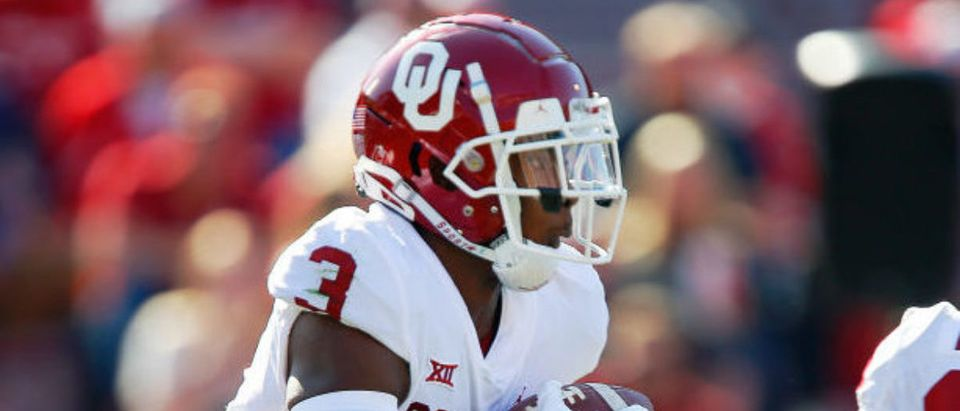 NORMAN, OK - APRIL 24: Running back Mikey Henderson #3 of the Oklahoma Sooners takes the ball for go during their spring game at Gaylord Family Oklahoma Memorial Stadium on April 24, 2021 in Norman, Oklahoma. (Photo by Brian Bahr/Getty Images)