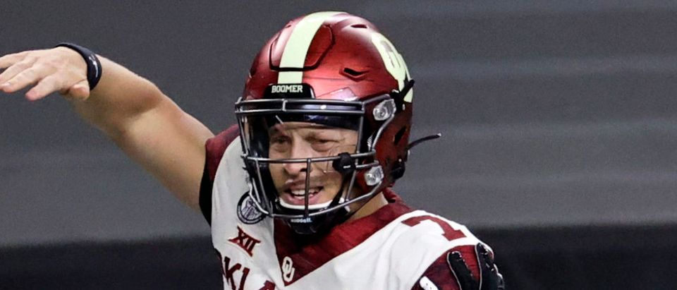 Dec 19, 2020; Arlington, Texas, USA; Oklahoma Sooners quarterback Spencer Rattler (7) reacts with tight end Mikey Henderson (3) after running for a touchdown during the second quarter against the Iowa State Cyclones at AT&T Stadium. Mandatory Credit: Kevin Jairaj-USA TODAY Sports via Reuters