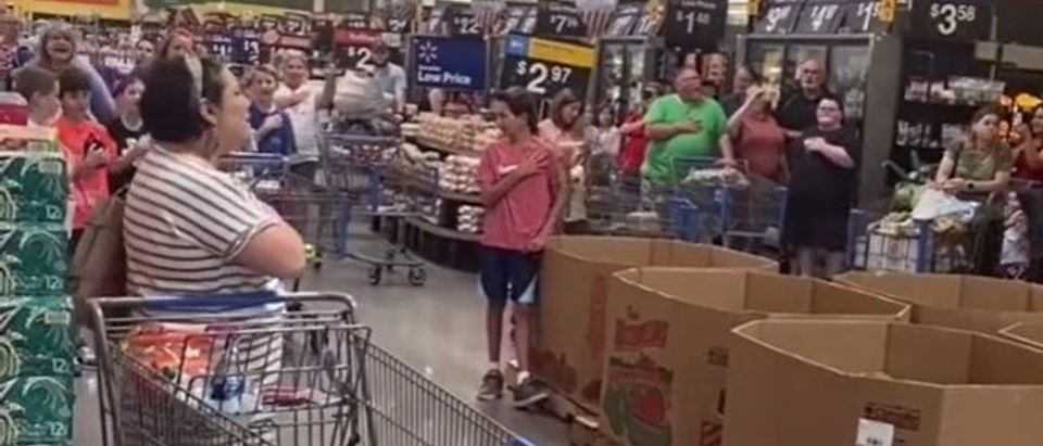 Patriotic shoppers sing the National Anthem in a Texas Walmart [Tik Tok Screenshot Raised Right]