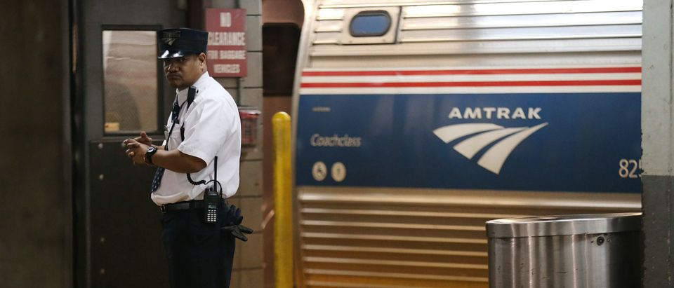 A train conductor stands next to an Amtrak train at New York's Pennsylvania Station on February 16, 2018 in New York City. (Photo by Spencer Platt/Getty Images)