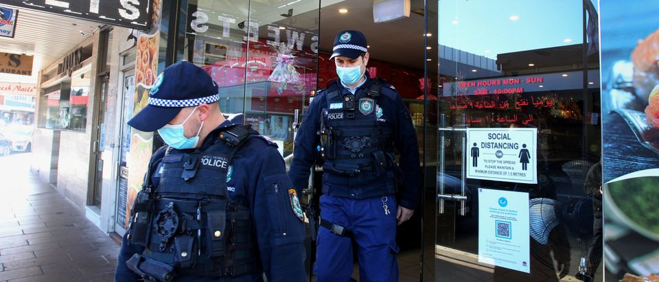 NSW Police Officers conduct COVID-19 compliance checks with shop owners in Fairfield on July 30, 2021 in Sydney, Australia. (Photo by Lisa Maree Williams/Getty Images)