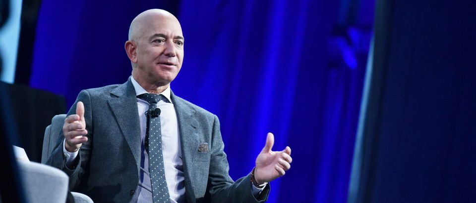 Amazon founder Jeff Bezos speaks after receiving the 2019 International Astronautical Federation (IAF) Excellence in Industry Award. (Photo by MANDEL NGAN/AFP via Getty Images)