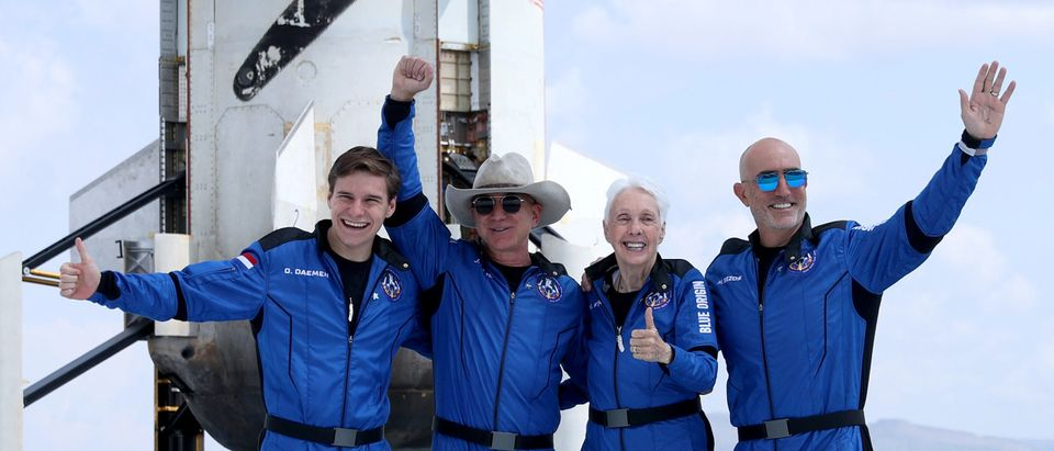 Blue Origin's New Shepard crew and Jeff Bezos pose for a picture. (Photo by Joe Raedle/Getty Images)