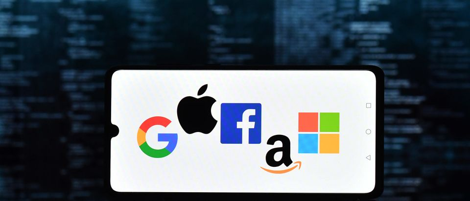 An illustration picture shows the logos of Google, Apple, Facebook, Amazon and Microsoft displayed on a mobile phone. (Photo by JUSTIN TALLIS/AFP via Getty Images)
