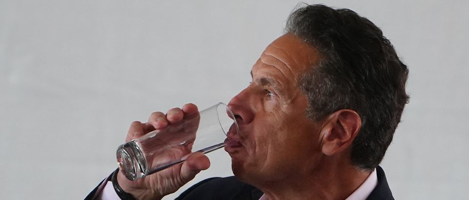 New York Gov. Andrew Cuomo drinks water during the opening ceremony for the Tribeca Film Festival on June 9, 2021 in New York City. (Photo by Carlo Allegri-Pool/Getty Images)